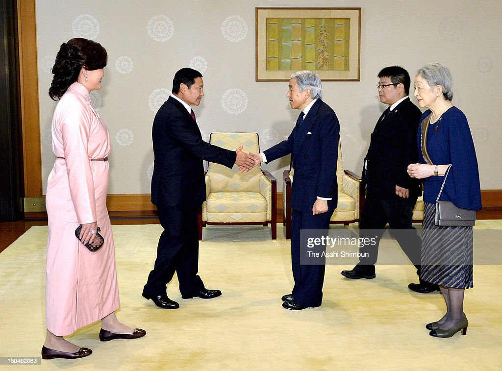 Emperor Akihito (3rd R) and Mongolian Prime Minister Norov Altankhuyag (2nd L) shake hands while <a gi-track='captionPersonalityLinkClicked' href=/galleries/search?phrase=Empress+Michiko&family=editorial&specificpeople=158725 ng-click='$event.stopPropagation()'>Empress Michiko</a> (1st R) and Altankhuyag's wife Khonichin Selenge (1st L) watch during their meeting at the Imperial Palace on September 13, 2013 in Tokyo, Japan.