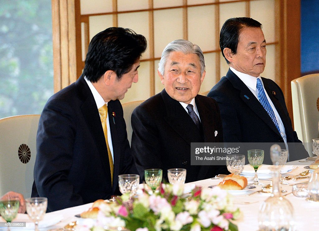 Emperor Akihito and Prime Minister <a gi-track='captionPersonalityLinkClicked' href=/galleries/search?phrase=Shinzo+Abe&family=editorial&specificpeople=559017 ng-click='$event.stopPropagation()'>Shinzo Abe</a> speak during the luncheon hosted by the emperor at the Imperial Palace on December 19, 2013 in Tokyo, Japan.