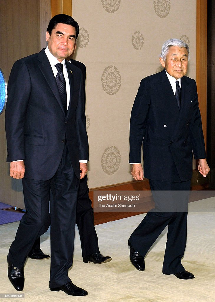 Emperor Akihito (R) and Turkmenistan President Gurbanguly Berdimuhamedo (L) enter a room prior to their meeting at the Imperial Palace on September 12, 2013 in Tokyo, Japan.