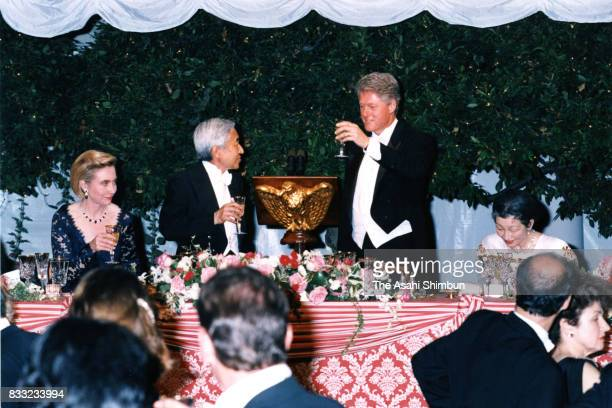 Emperor Akihito and US President Bill Clinton toast glasses during the state dinner at the Rose Garden of the White House on June 13 1994 in...