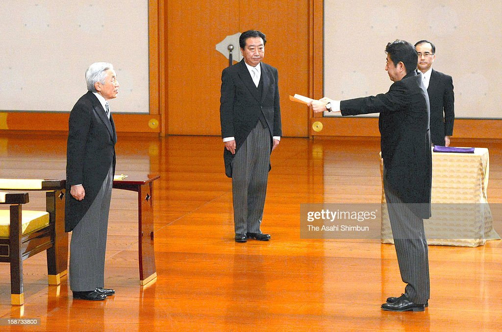 Emperor Akihito (L) appoints <a gi-track='captionPersonalityLinkClicked' href=/galleries/search?phrase=Shinzo+Abe&family=editorial&specificpeople=559017 ng-click='$event.stopPropagation()'>Shinzo Abe</a> as Japan's new prime Minister while predecessor <a gi-track='captionPersonalityLinkClicked' href=/galleries/search?phrase=Yoshihiko+Noda&family=editorial&specificpeople=6441440 ng-click='$event.stopPropagation()'>Yoshihiko Noda</a> observes at the Imperial Palace on December 26, 2012 in Tokyo, Japan. Abe filled his Cabinet with economic policy veterans, who are also close colleagues, in hopes that resuscitating the Japanese economy will propel his party to victory in the Upper House election next summer.