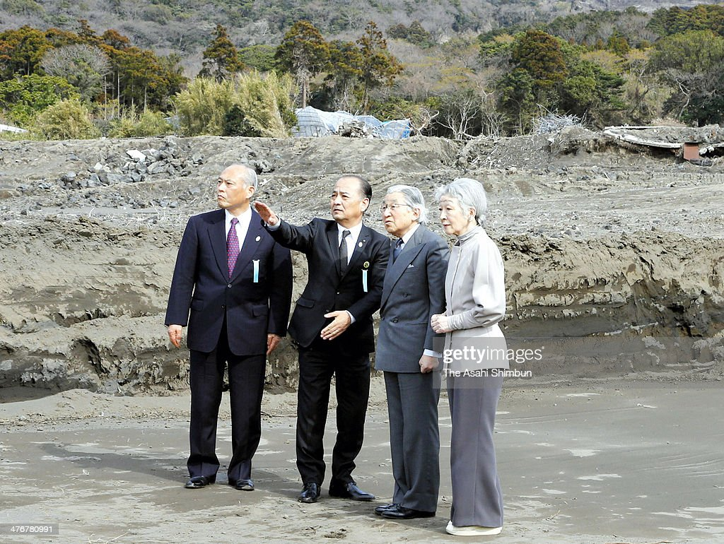 Emperor Akihito (2nd R), <a gi-track='captionPersonalityLinkClicked' href=/galleries/search?phrase=Empress+Michiko&family=editorial&specificpeople=158725 ng-click='$event.stopPropagation()'>Empress Michiko</a> (1st R) and new Tokyo Governor <a gi-track='captionPersonalityLinkClicked' href=/galleries/search?phrase=Yoichi+Masuzoe&family=editorial&specificpeople=4473580 ng-click='$event.stopPropagation()'>Yoichi Masuzoe</a> (1st L) listen to an explanation from Oshima Town Mayor Masafumi Kawashima (2nd L) during their visit to landslide devasted Izu Oshima island on February 28, 2014 in Oshima, Tokyo, Japan.