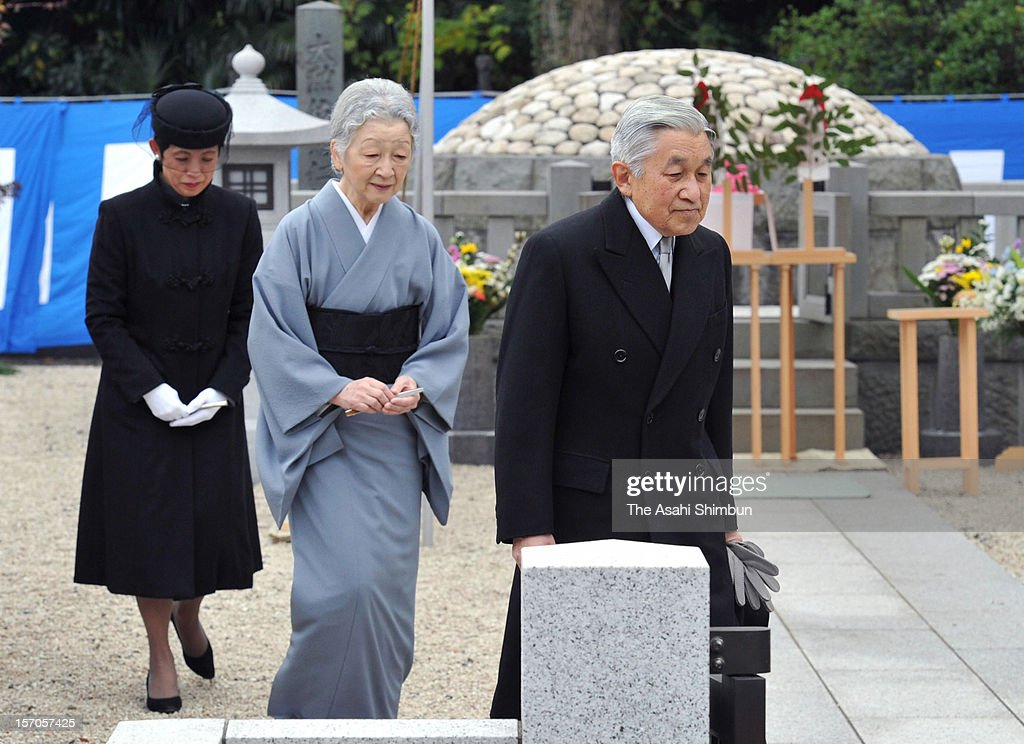 Emperor Akihito (R), <a gi-track='captionPersonalityLinkClicked' href=/galleries/search?phrase=Empress+Michiko&family=editorial&specificpeople=158725 ng-click='$event.stopPropagation()'>Empress Michiko</a> (C) and Princess Takamado (L) visit the grave of Prince Takamado at Toshimagaoka Cemetary on November 28, 2012 in Tokyo, Japan. Emperor and Empress did not attend the memorial service held on November 21, 10th anniversary of the death of Prince Takamado in accordance with customary practice.