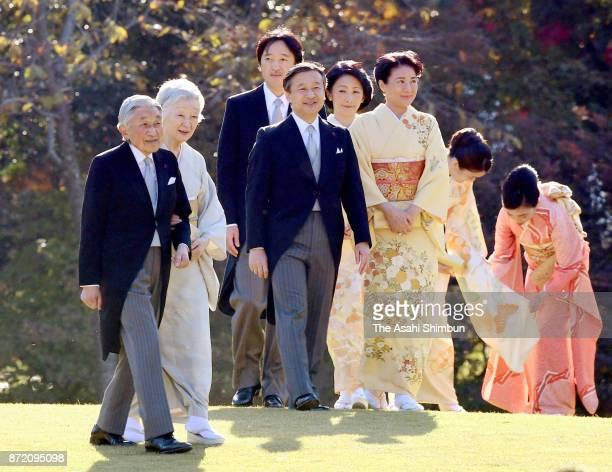 Emperor Akihito Empress Michiko and royal family members walk toward guests during the Autumn Garden Party at the Akasaka Imperial Garden on November...