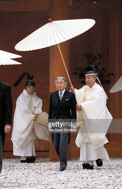 Emperor Akihito leaves the main hall of Geku outer shrine during his visit to Ise Shrine on March 26 2014 in Ise Mie Japan The Imperial Regalia or...