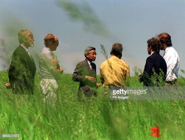 Emperor Akihito of Japan wound up his controversial state visit to Britain with a stroll around a farm today with Sir Ghillian Prance director of Kew...