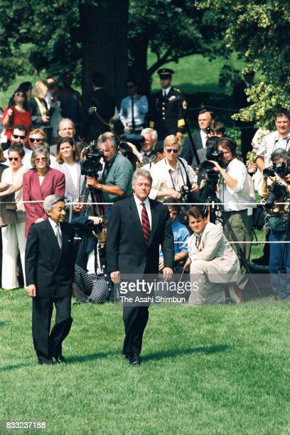 Emperor Akihito reviews the honour guard with the US President Bill Clinton during the welcome ceremony at the South Garden of the White House on...