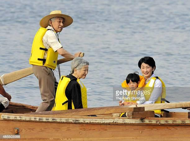 Emperor Akihito rows a boat for Empress Michiko Prince Hisahito and Princess Kiko of Akishino during his stay at the Hayama Imperial Villa on...