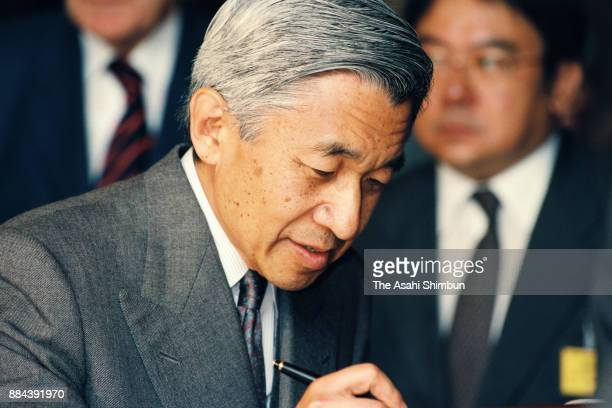 Emperor Akihito signs on the visitors' book at the National Museum of Natural History on October 6 1994 in Paris France