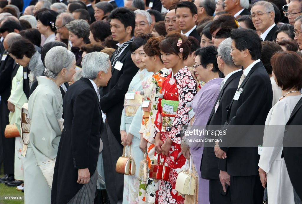 Emperor Akihito speaks to London Olympic Judo Women's 57kg gold medalist <a gi-track='captionPersonalityLinkClicked' href=/galleries/search?phrase=Kaori+Matsumoto&family=editorial&specificpeople=4919959 ng-click='$event.stopPropagation()'>Kaori Matsumoto</a> while <a gi-track='captionPersonalityLinkClicked' href=/galleries/search?phrase=Empress+Michiko&family=editorial&specificpeople=158725 ng-click='$event.stopPropagation()'>Empress Michiko</a> speaks to three times Olympic gold medalist in Women's wrestling 55kg <a gi-track='captionPersonalityLinkClicked' href=/galleries/search?phrase=Saori+Yoshida&family=editorial&specificpeople=2374710 ng-click='$event.stopPropagation()'>Saori Yoshida</a> during the Imperial Autumn Party at the Akasaka Imperial Garden on October 25, 2012 in Tokyo, Japan.