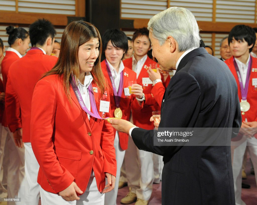 Emperor Akihito (R) speaks to the gold medalist in women's wrestling freestyle 55kg <a gi-track='captionPersonalityLinkClicked' href=/galleries/search?phrase=Saori+Yoshida&family=editorial&specificpeople=2374710 ng-click='$event.stopPropagation()'>Saori Yoshida</a> during a tea party at the Imperial Palace on October 15, 2012 in Tokyo, Japan.