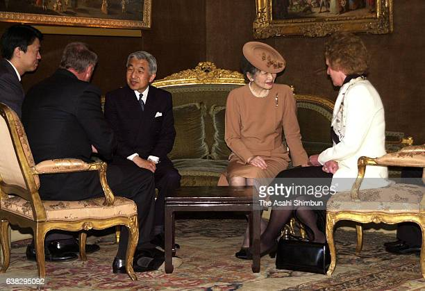 Emperor Akihito talks with Swiss President Adolf Ogi while Empress Michiko talks with Ogi's wife Katrin Marti on May 22 2000 in Geneva Switzerland