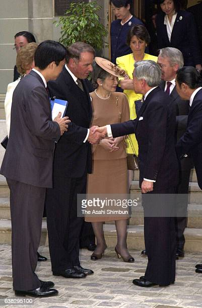 Emperor Akihito talks with Swiss President Adolf Ogi while Empress Michiko listens on May 22 2000 in Geneva Switzerland
