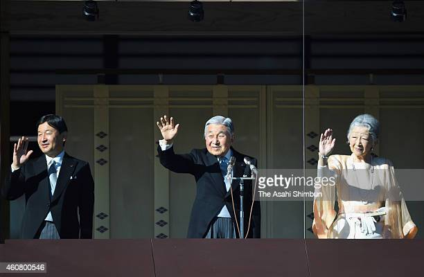Emperor Akihito waves to wellwishers along with Empress Michiko and Crown Prince Naruhito at the Imperial Palace on December 23 2014 in Tokyo Japan...