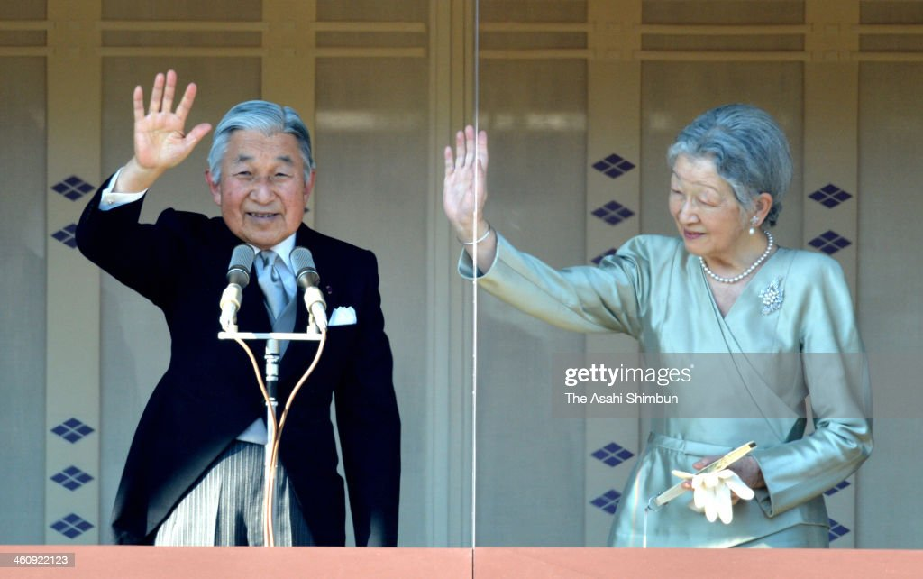 Emperor Akihito (L) waves to well-wishers next to <a gi-track='captionPersonalityLinkClicked' href=/galleries/search?phrase=Empress+Michiko&family=editorial&specificpeople=158725 ng-click='$event.stopPropagation()'>Empress Michiko</a> during celebrations for the New Year on the veranda of the Imperial Palace on January 2, 2014 in Tokyo, Japan. In his address to the waiting members of the public, Emperor Akihito wished happiness for the nation and expressed his continuing concern for those still affected by the 2011 earthquake and tsunami.