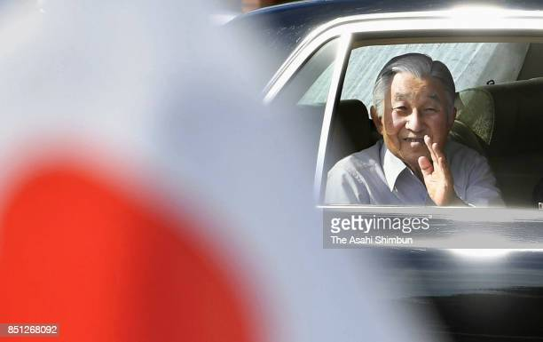 Emperor Akihito waves to wellwishers on arrival at the Shibusawa Eiichi Museum on September 21 2017 in Fukaya Saitama Japan