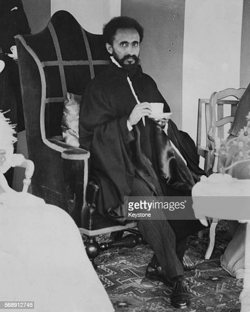 Emperor Haile Selassie of Ethiopia drinking a cup of tea during a garden party at Lincoln House Parkside London June 8th 1936