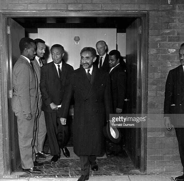 Emperor Haile Selassie of Ethiopia leaving a building with his minders September 30th 1964