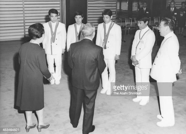 Emperor Hirohito and Empress Nagako meet with Sapporo Olympic ski jumpers Seiji Aochi Akitsugu Konno and Yukio Kasaya at the Imperial Palace on...