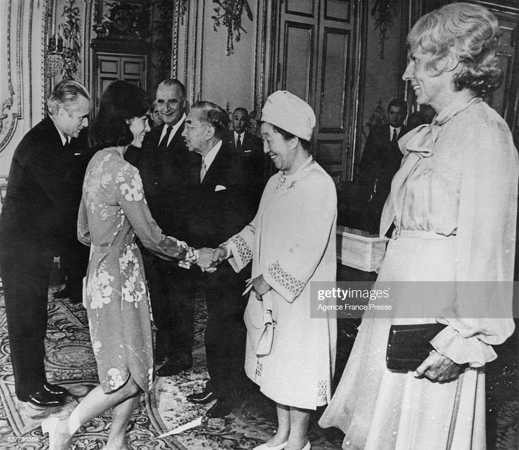 Emperor Hirohito and Empress Nagako of Japan attend a luncheon at the Elysee Palace during a three-day visit to Paris, France, 2nd October 1971. Here they greet French Prime Minister Jacques Chaban-Delmas and his wife Micheline, while President Georges Pompidou and his wife Claude look on.