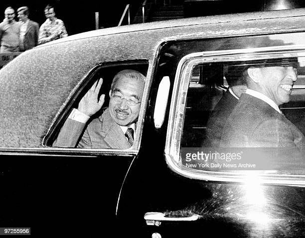 Emperor Hirohito of Japan acknowledges greetings as he leaves the WaldorfAstoria Hotel