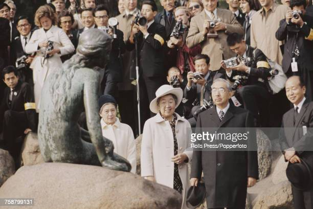 Emperor Hirohito of Japan and Empress Nagako pictured observing The Little Mermaid statue in Copenhagen Denmark on 28th September 1971 Emperor...