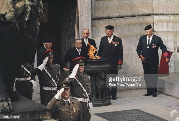 Emperor Hirohito of Japan attending a commemoration ceremony beside the eternal flame at the monument to the unknown soldier situated at the base of...