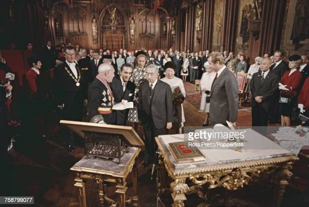 Emperor Hirohito of Japan pictured signing the visitors book at Brussels Town Hall situated on the Grand Place in Brussels Belgium on 29th September...