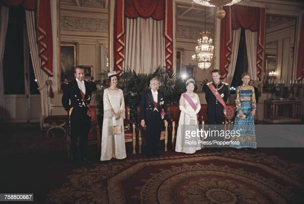 Emperor Hirohito of Japan pictured with King Baudouin of Belgium and other members of the Belgian royal family at a state dinner in Brussels Belgium...