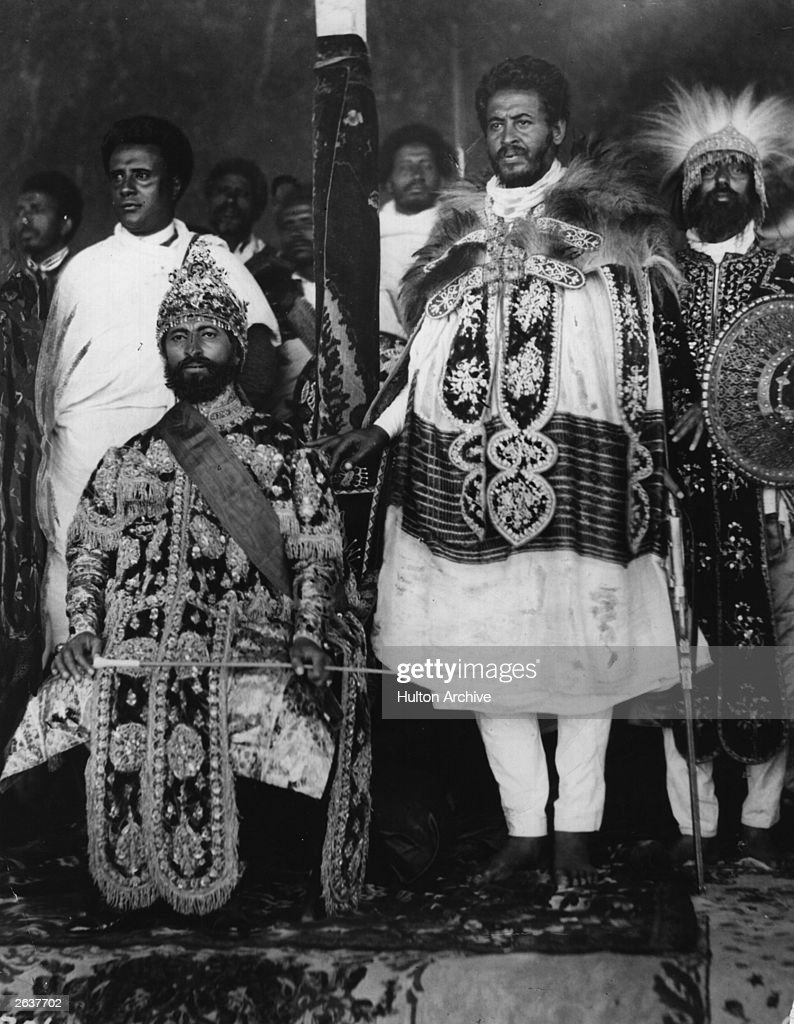 Emperor of Ethiopia Haile Selassie I (1891 - 1975) seated in state in Addis Ababa with his courtiers in elaborate national dress.
