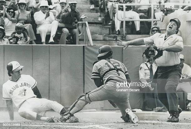 Emphatic Ump Home plate umpire Larry McCoy lets the world know in no uncertain terms that Blue Jays' Bob Bailor was safe with first run of 41 victory...