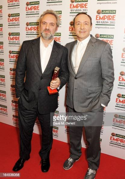 Empire Inspiration award winner Sam Mendes and Kevin Spacey pose in the press room at the Jameson Empire Awards 2013 at The Grosvenor House Hotel on...