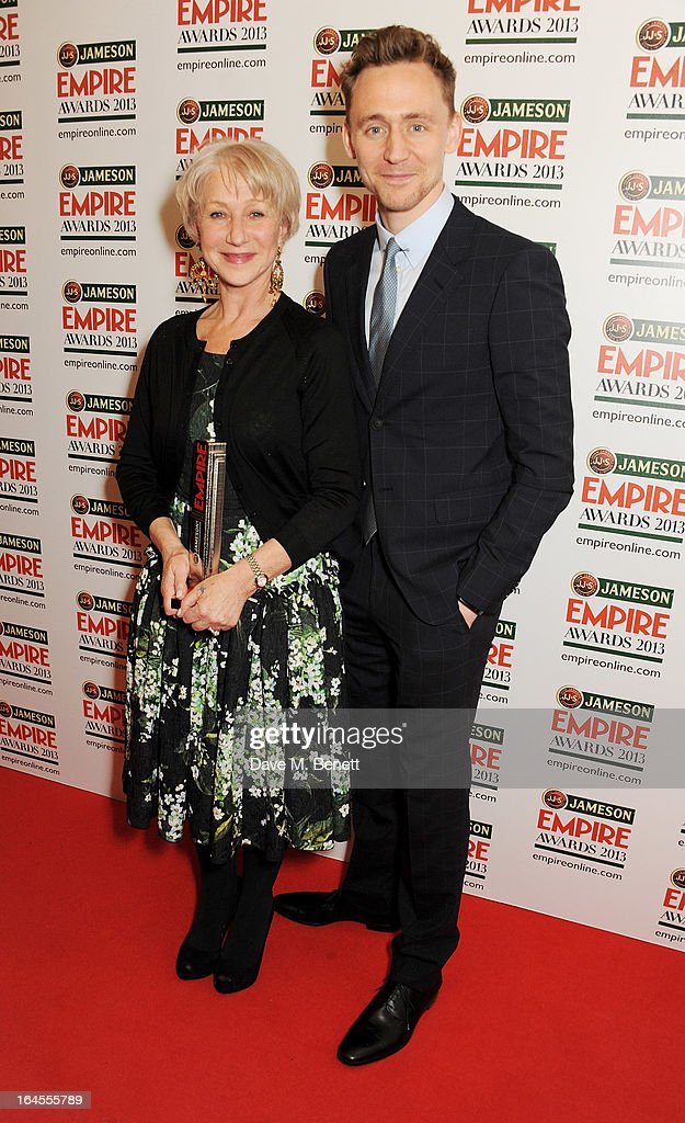 Empire Legend winner Dame Helen Mirren (L) and Tom Hiddleston pose in the press room at the Jameson Empire Awards 2013 at The Grosvenor House Hotel on March 24, 2013 in London, England.