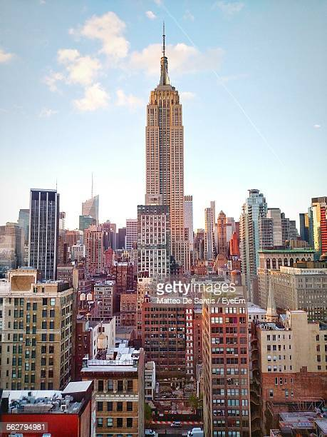Empire State Building Amidst Modern Towers In City