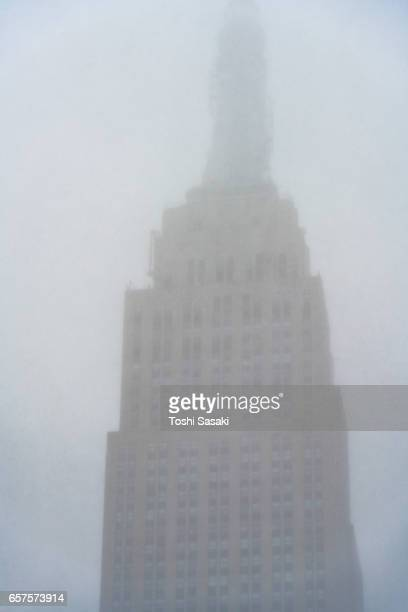 Empire State Building that is veiled during the snowstorm at Midtown Manhattan on Mar. 14 2017.