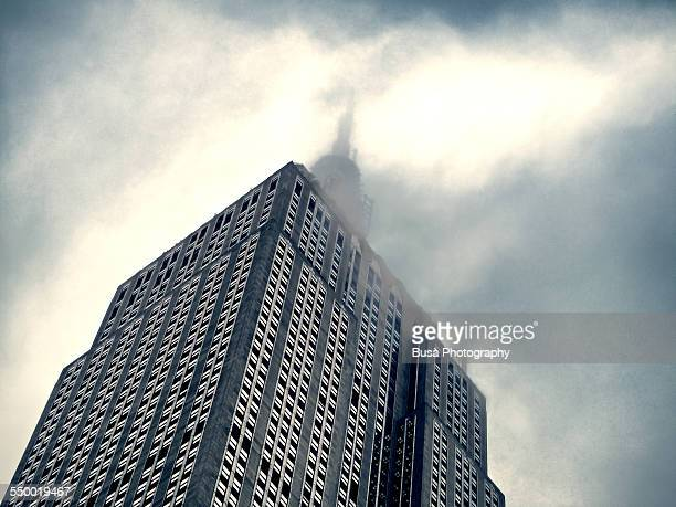 Empire State Building vanishing in the clouds