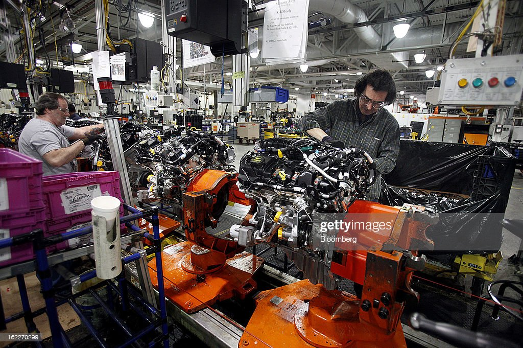Employee assemble 2.0 liter ecoboost engines on the production line at the Ford Motor Co. Cleveland Engine Plant in Brook Park, Ohio, U.S., on Thursday, Feb. 21, 2013. Ford Motor Co. said it will invest $200 million to make four-cylinder engines at the plant starting in late 2014 as the second-largest U.S. automaker equips an increasing number of models with smaller, more fuel-efficient powertrains. Photographer: David Maxwell/Bloomberg via Getty Images