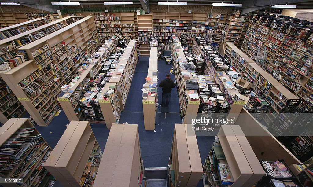 A employee at the Bookbarn International looks for a second hand book that has been ordered over the Internet in their warehouse on December 12, 2008 near Hallatrow in Somerset, England. Currently selling up to several thousand books a day and mostly online via Web sites such as Amazon.com, Bookbarn International is the UK's largest second hand book warehouse with over 5 million titles stored in two giant barns in a field in Somerset. Helped in part by the credit crunch, sales of second hand books have risen sharply recently with the weak British pound only helping the Bookbarn to sell more books internationally. (Photo by Matt Cardy/Getty Images).