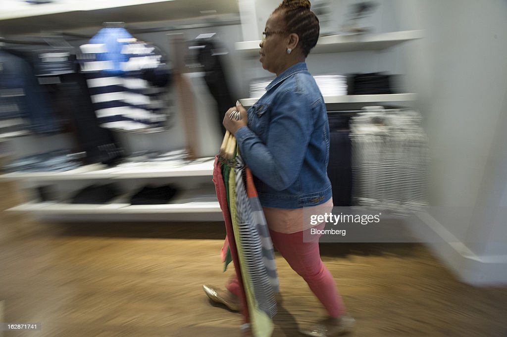 Employee Charlotte Crier carries clothes inside a Gap Inc. store in San Francisco, California, U.S., on Thursday, Feb. 28, 2013. Gap Inc., the biggest U.S. specialty-apparel retailer, rose after posting fourth-quarter profit that topped analysts' estimates, fueled by its best holiday shopping season in six years. Photographer: David Paul Morris/Bloomberg via Getty Images