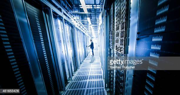 Employee checking server racks at the new data center of TSystems a subsidiary of Deutsche Telekom AG on July 01 in Biere Germany TSystems is the...