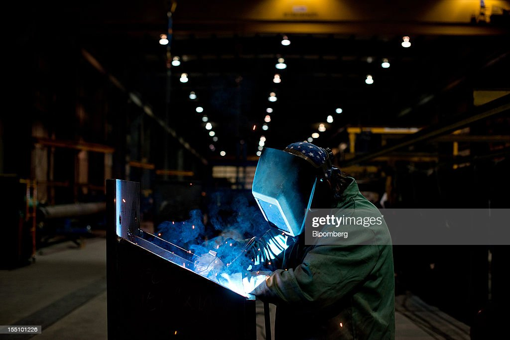 Employee Chris Swearingen welds a horizontal section of a large 'H' frame at the Rohn Products LLC manufacturing facility in Peoria, Illinois, U.S., on Wednesday, Oct. 31, 2012. Manufacturing in the U.S. probably expanded in October at a slower pace, indicating the industry is providing little thrust for the expansion, economists said before a report today. Photographer: Daniel Acker/Bloomberg via Getty Images