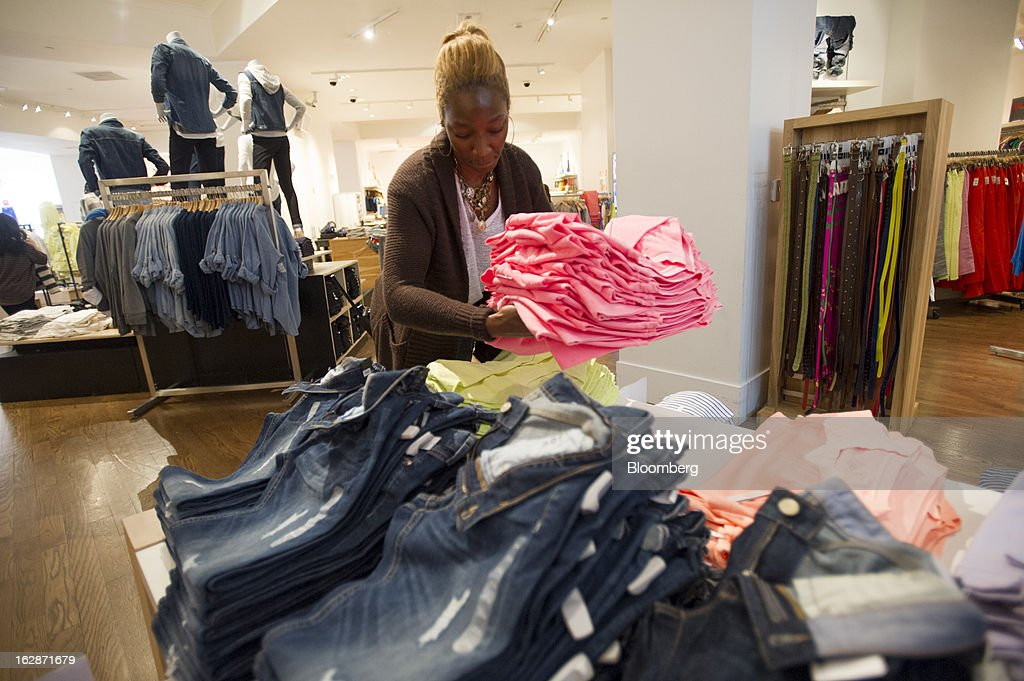 Employee Corrie Green folds clothes for display at a Gap Inc. store in San Francisco, California, U.S., on Thursday, Feb. 28, 2013. Gap Inc., the biggest U.S. specialty-apparel retailer, rose after posting fourth-quarter profit that topped analysts' estimates, fueled by its best holiday shopping season in six years. Photographer: David Paul Morris/Bloomberg via Getty Images