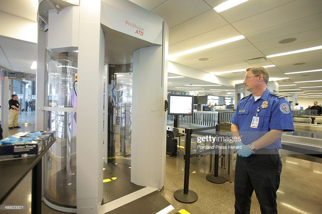 TSA employee Dale Tucker stands near one of three new passenger screening devices in their security checkpoint area at the Portland International...