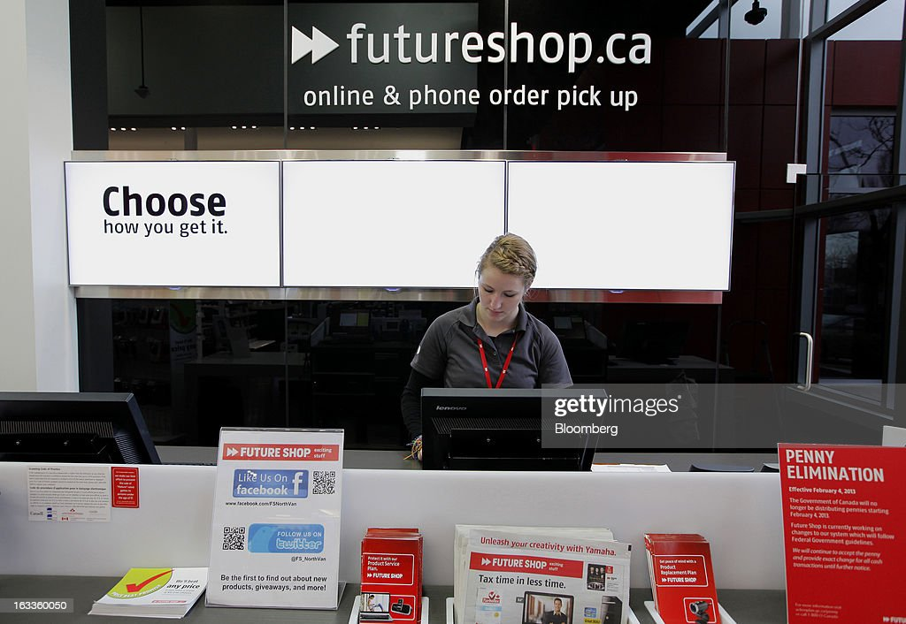 Employee Danielle Plamondon works at a Future Shop store in Vancouver, British Columbia, Canada, on Thursday, March 7, 2013. Future Shop, Canada's largest consumer electronics retailer, offers home and entertainment products, including televisions, computers, cameras, MP3 players, video games, computer add-ons, software, and audo and video systems. Photographer: Deddeda White/Bloomberg via Getty Images