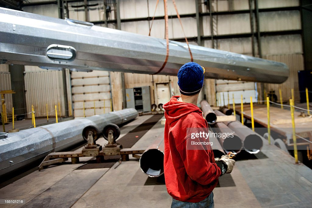 Employee David Claudin moves a large steel pole using an overhead crane at the Rohn Products LLC manufacturing facility in Peoria, Illinois, U.S., on Wednesday, Oct. 31, 2012. Manufacturing in the U.S. probably expanded in October at a slower pace, indicating the industry is providing little thrust for the expansion, economists said before a report today. Photographer: Daniel Acker/Bloomberg via Getty Images