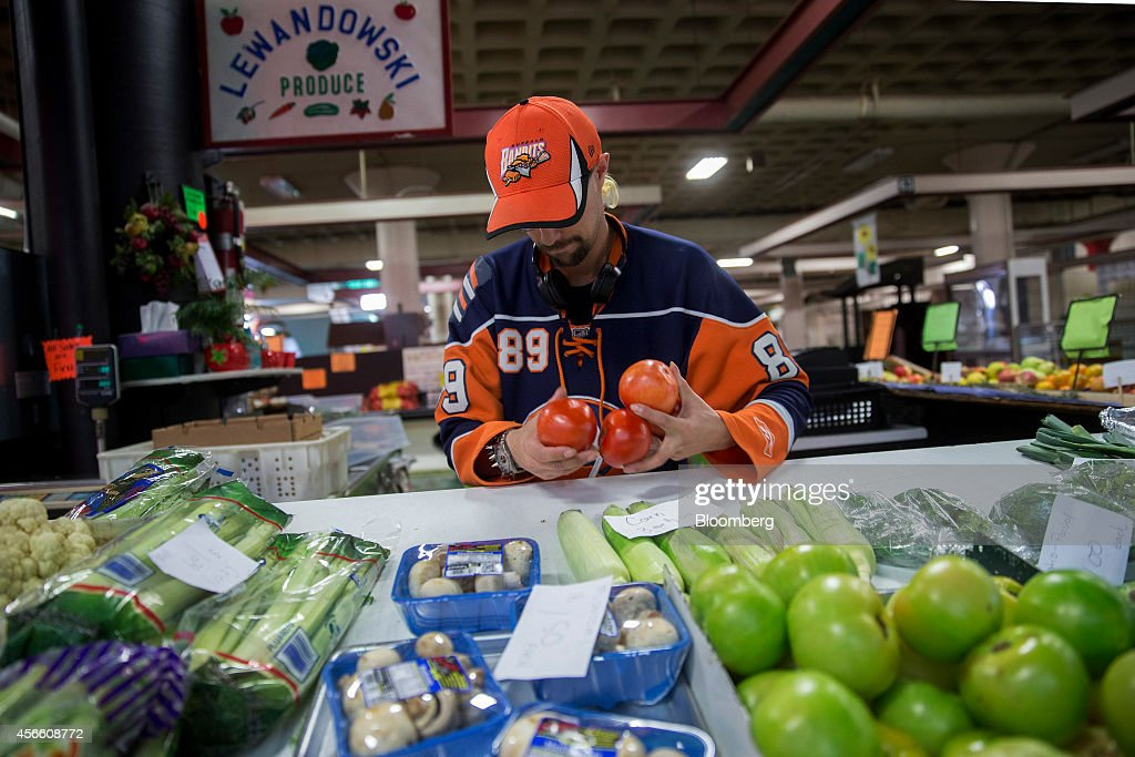 Employee David Jimerson packages a customer's order at Lewandowski Produce inside the Broadway Market in Buffalo New York US on Wednesday Sept 24...