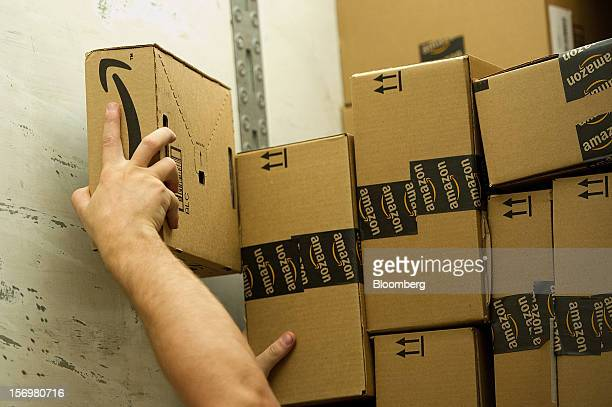 Employee David Pace loads a truck with boxes to be shipped at the Amazoncom Inc distribution center in Phoenix Arizona US on Monday Nov 26 2012 US...