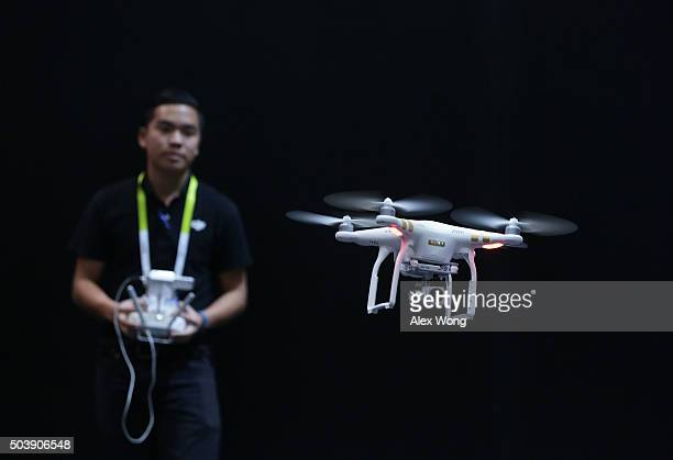 DJI employee demonstrates flying a drone at CES 2016 at the Las Vegas Convention Center on January 7 2016 in Las Vegas Nevada CES the world's largest...