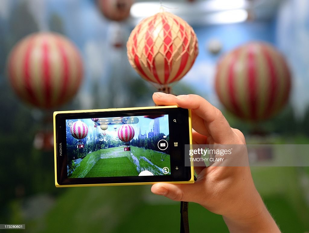 A employee demonstrates the photo capabilities of the Nokia Lumia 1020 a Windows Phone with a 41megapixel camera after its unveiling in New York City...