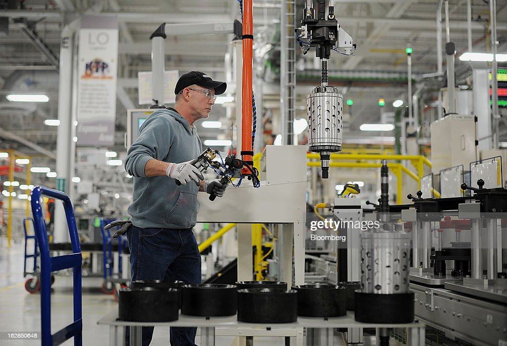 Employee Dietz Werland removes transmission parts from the assembly line at the Chrysler Group LLC transmission plant in Kokomo, Indiana, U.S., on Thursday, Feb. 28, 2013. Chrysler Group LLC, the automaker majority owned by Fiat SpA, will invest about $374 million and add 1,250 jobs at Indiana factories to boost output of eight-and nine-speed transmissions. Photographer: Daniel Acker/Bloomberg via Getty Images